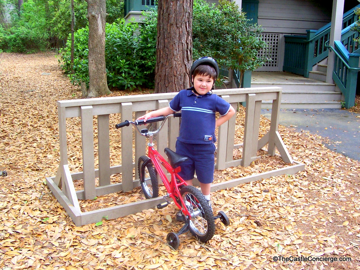 Make memories on vacation by teaching your child something new like bike riding.