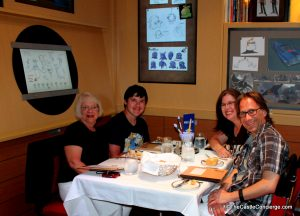Enjoying a family dinner on a Disney cruise ship