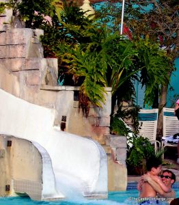 Father and son enjoy pool at Disney's Caribbean Beach Resort