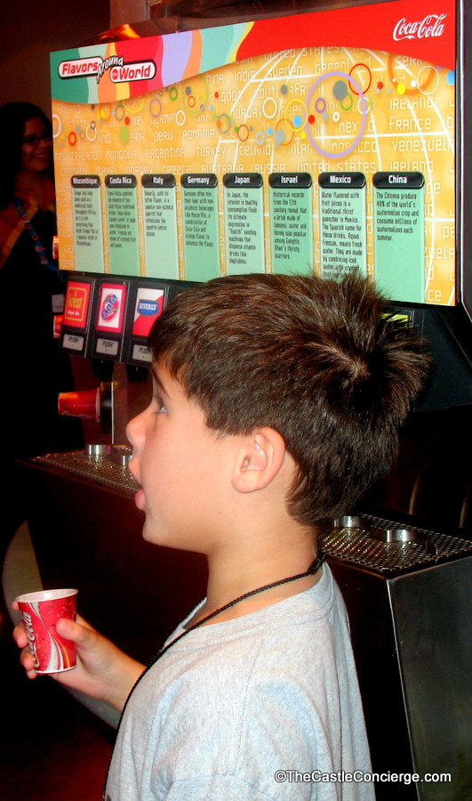 Child sipping beverage at Epcot's Club Cool