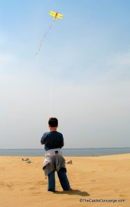 Flying Kite on Sand Dunes at Jockey's Ridge State Park, North Carolina.