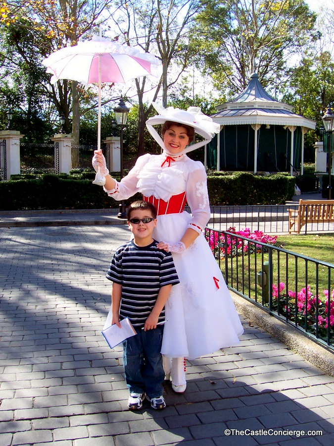 Child posing with Mary Poppins in Epcot's United Kingdom