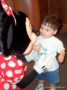 Child meeting Minnie Mouse for the first time.