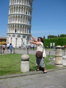 Take the classic picture holding up the Leaning Tower of Pisa in Italy.