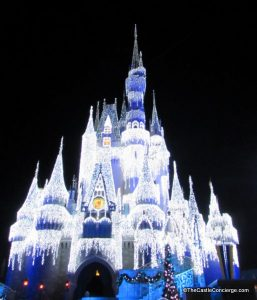 Cinderella's Castle is adorned with Dream Lights during the holiday season.